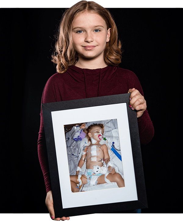 Champion Avery with a photo of herself as a baby