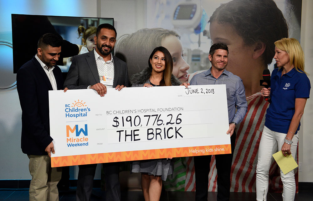 Presenting of a giant cheque from The Brick to BC Children's Hospital on Miracle Weekend