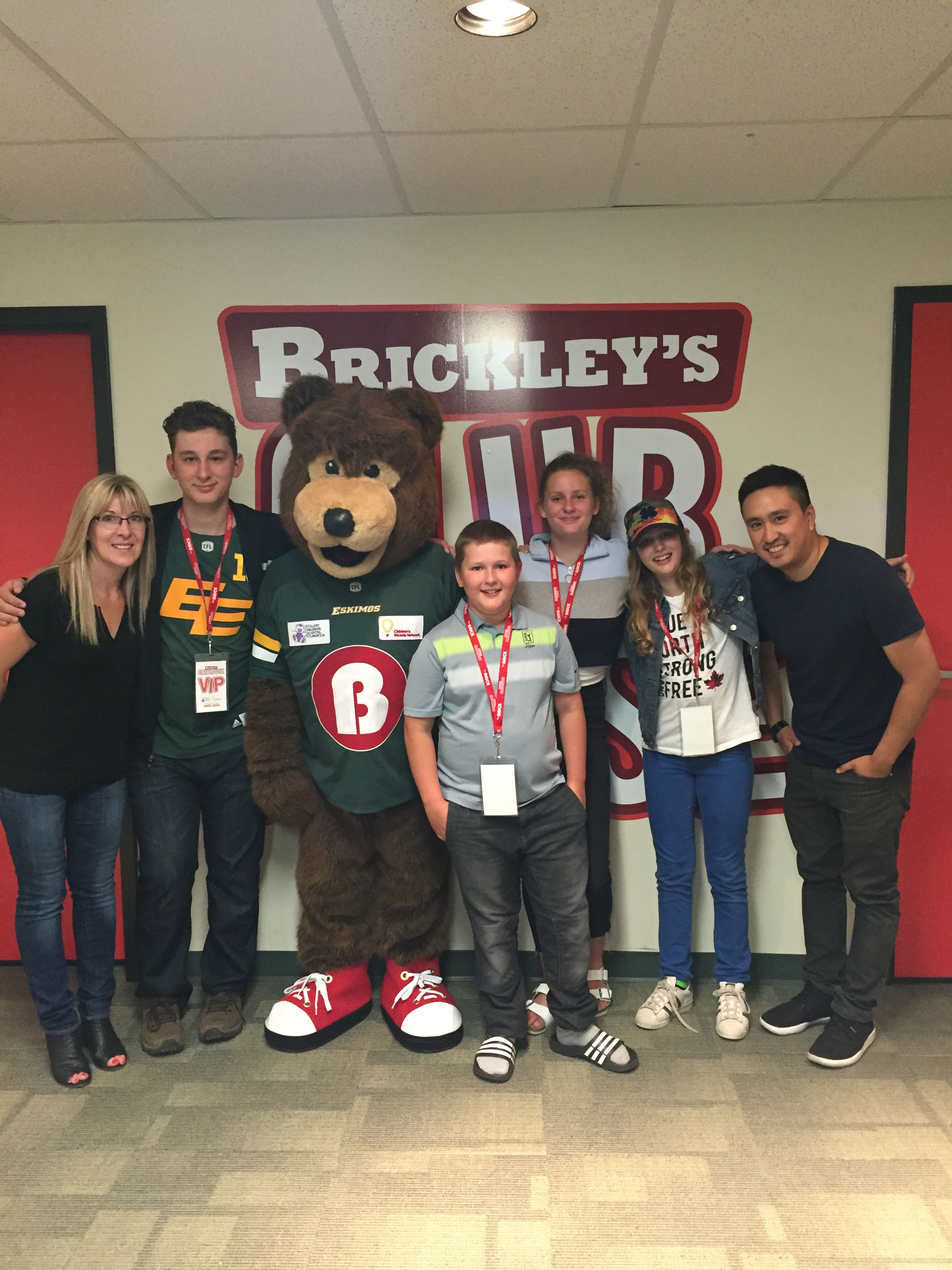 The Brick Mascot with parents and kids at Brickley's Club House