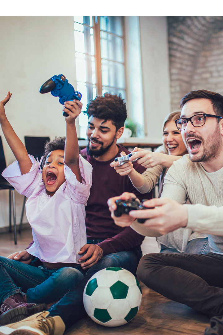 Adults and kid having fun playing video games