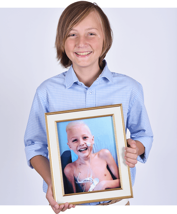 Jean-Gilles holding hospital photo of himself