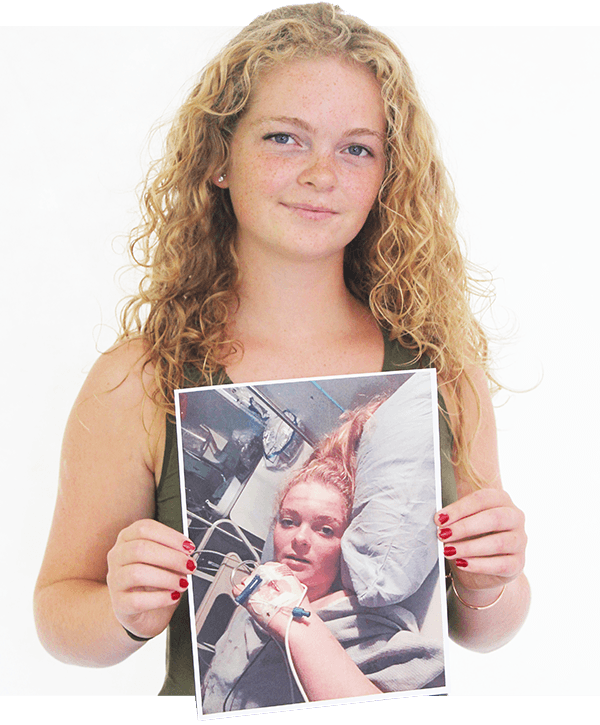Natalie holding photo of herself