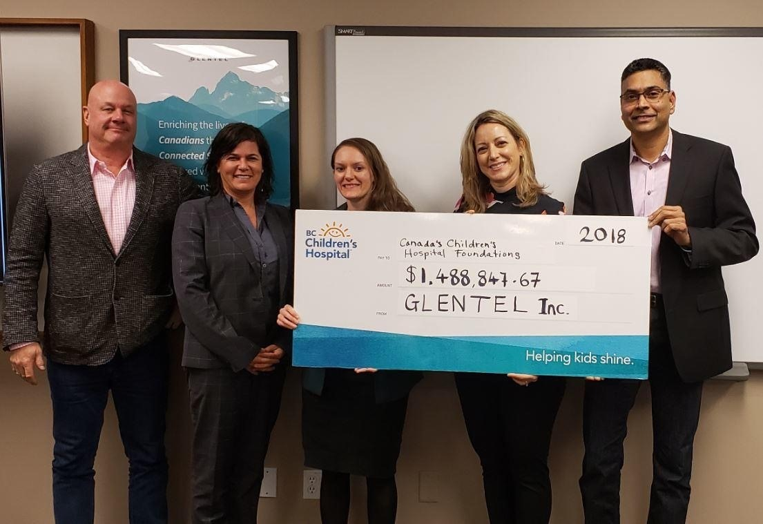Group of people holding a giant Glental cheque to B.C. Children's Hospital