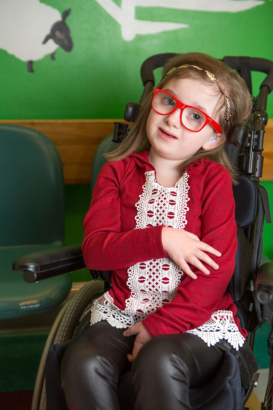 Little girl in red glasses