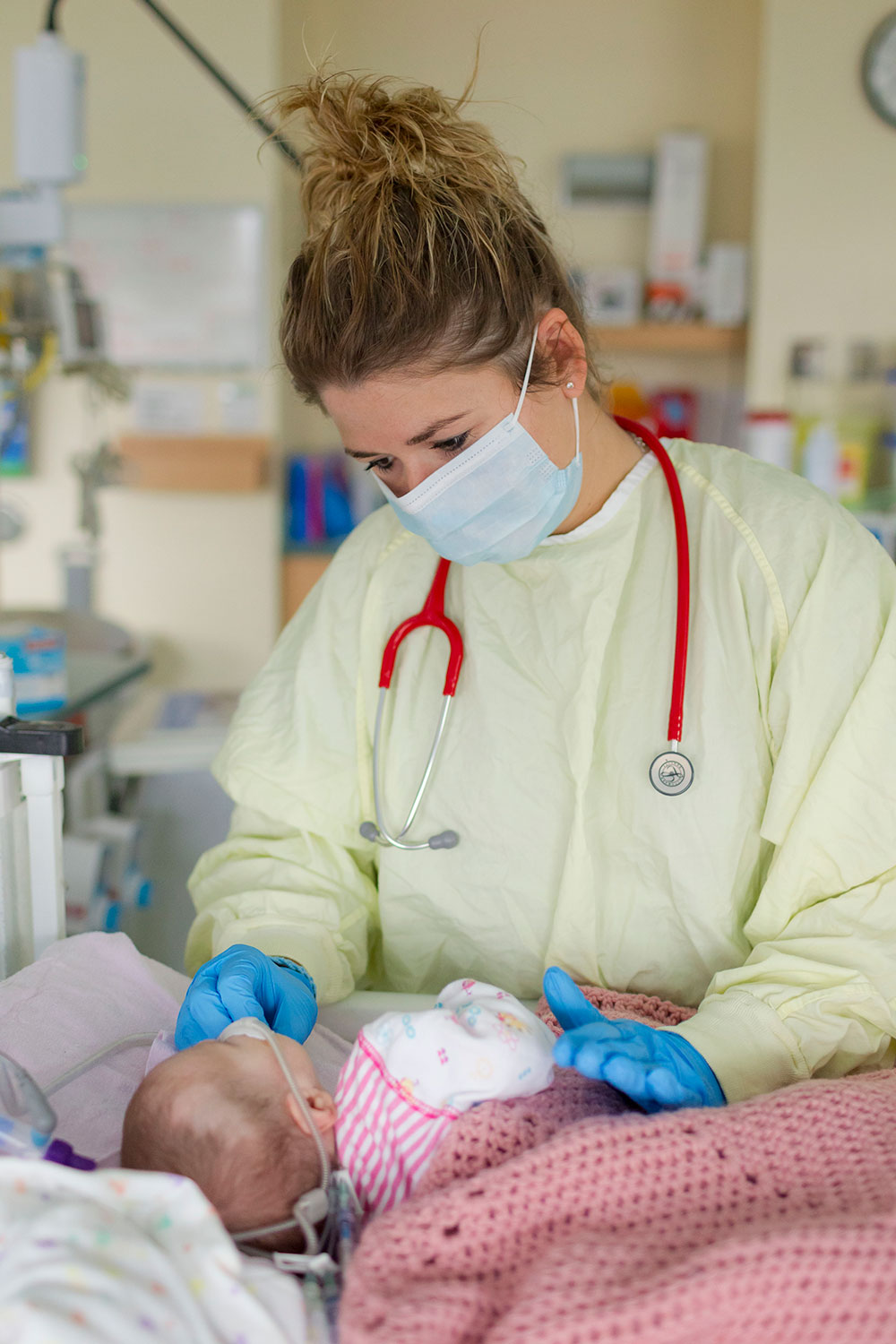 Baby being tended to by doctor