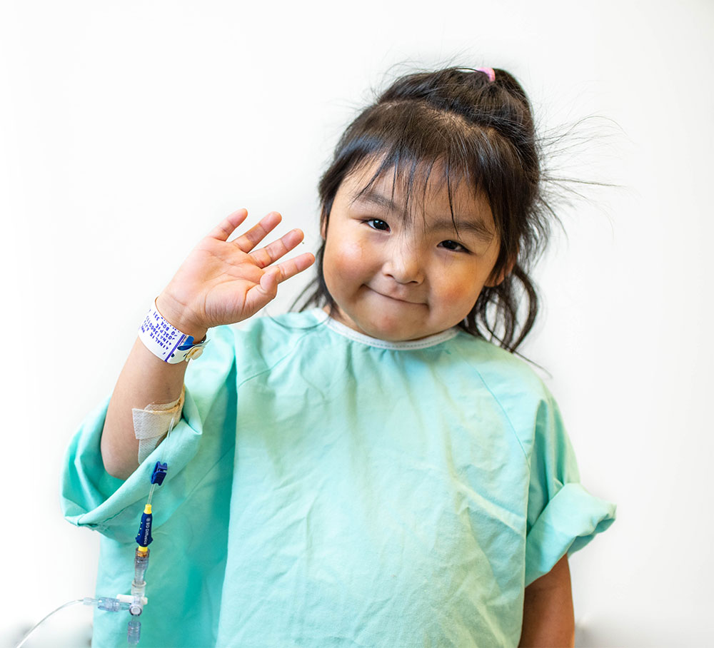 Little girl in hospital gown