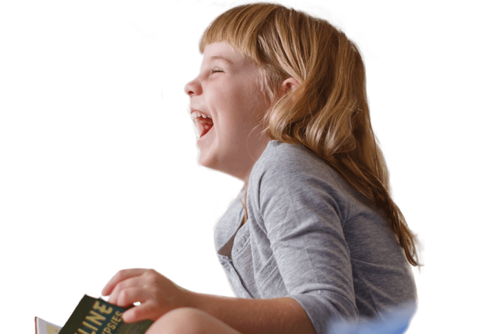 Laughing girl with book facing left