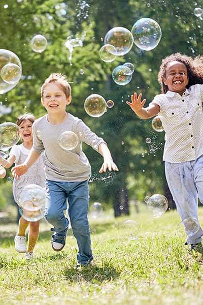 Running kids with bubbles