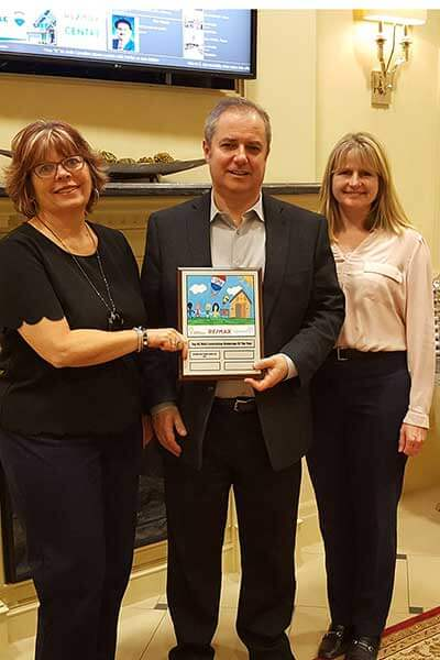 Three people awarded Remax plaque