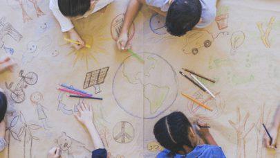 Kids drawing on big sheet of paper