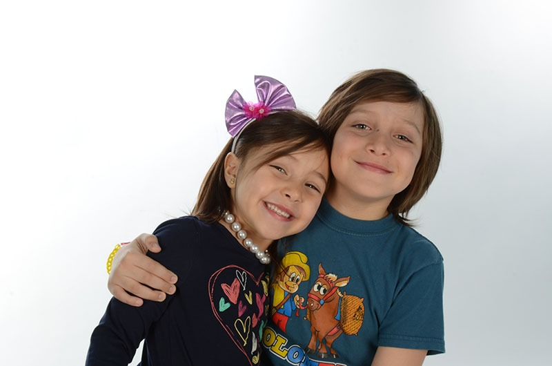 2 kids with arms around each other
