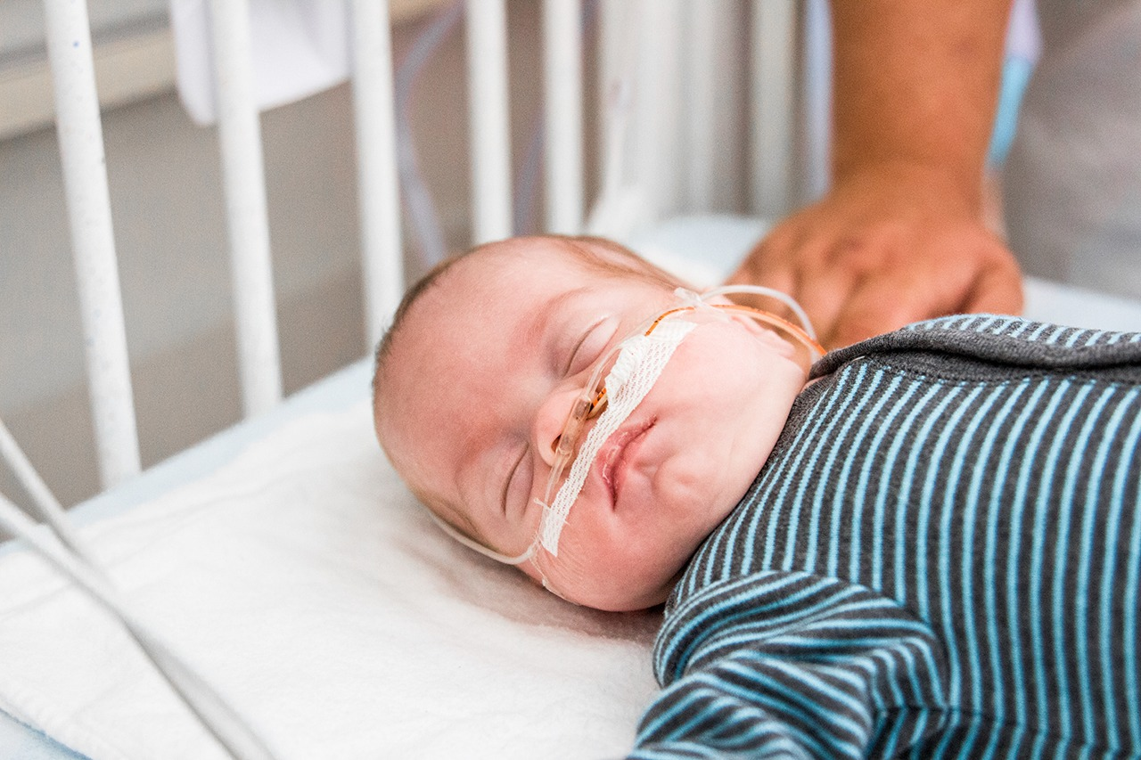 baby in monitored hospital bed