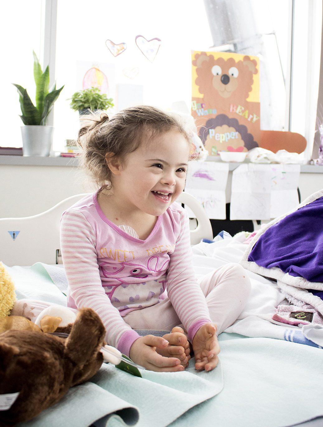 little girl in London hospital bed