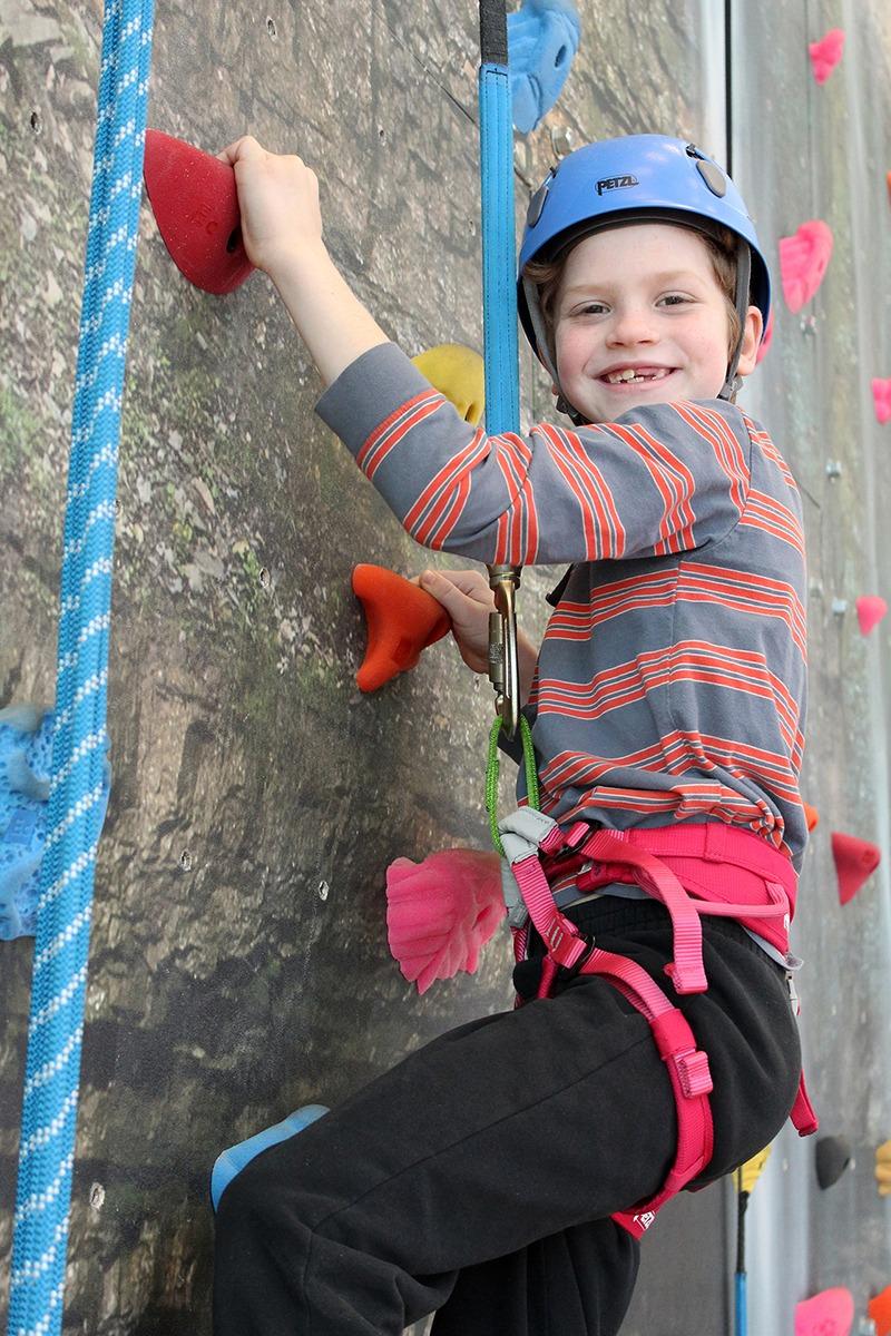 Girl from MMCHF rock climbing